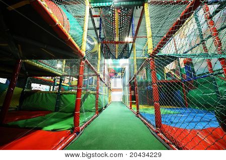 Playing room on which  possible  climb and  slide on pipes