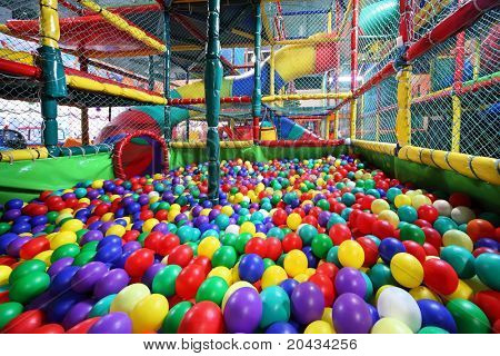Much varicoloured bright balls are poured in sector for slide from chute