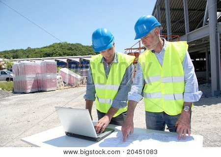 Industrial people working on building site
