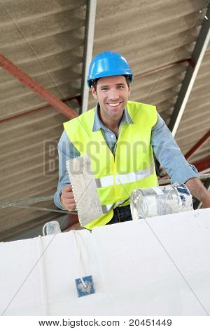 Bricklayer at work on construction site