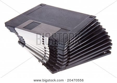 A Pile of 3.5 inch Computer Diskettes, isolated on white