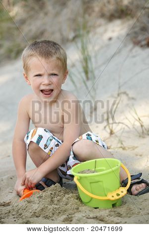 Young Boy Having Fun At Beach