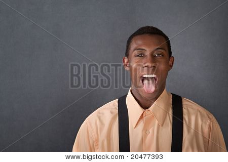 Young Man Shows His Tongue