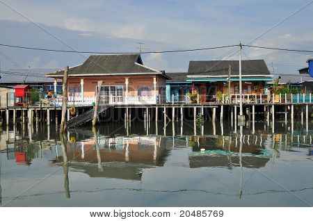 wooden houses build on the swamp of fishing village