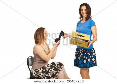 Seller Woman Showing Shoe To Client