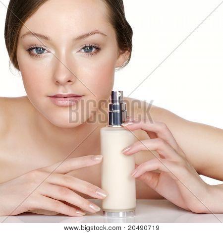 Woman with moisturizing emulsion