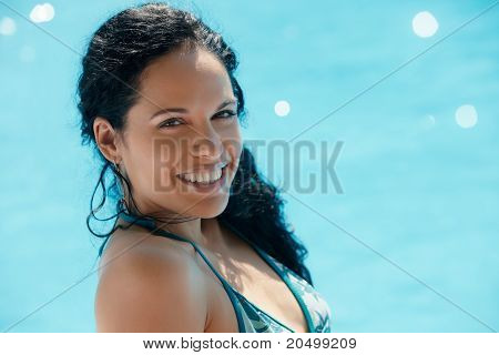 Young Woman Sitting In Swimming Pool