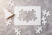 New Year Concept . Frame Of Jigsaw Puzzle On Grey Concrete Background. poster