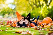 Kids With Pumpkins In Halloween Costumes poster