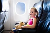 Child In Airplane. Flight With Kids. Family Flying. poster