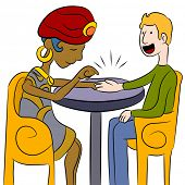 stock photo of seer  - An image of a psychic palm reader with a client - JPG