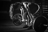 Woman Weightlifting On Training, Black And White Image, Black Background poster
