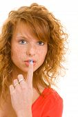 Woman Putting Finger On Her Lips