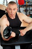 image of mature men  - Mature sporty man in the gym centre - JPG