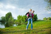 stock photo of have sweet dreams  - Kid and mother having fun outdoors - JPG
