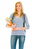 Smiling young girl with schoolbag holding schoolbooks in hands isolated on white poster