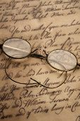 stock photo of bifocals  - Old glasses on the vintage document - JPG