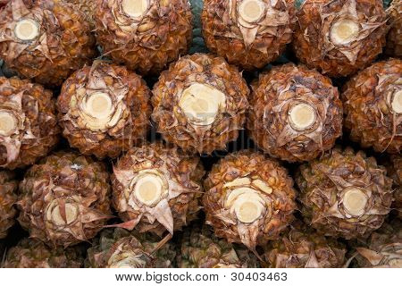 Close Up Of Pile Of Ripe Pineapples