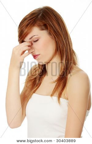 Young teen woman with sinus pressure pain