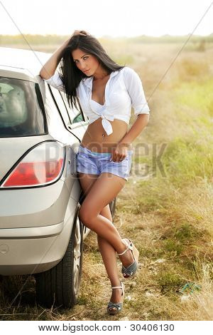 Sexy hot woman near car outdoor