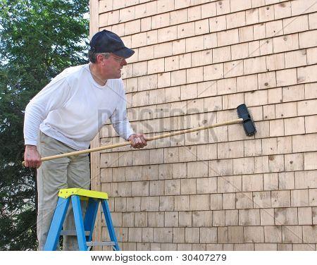 Man cleaning cedar shingles