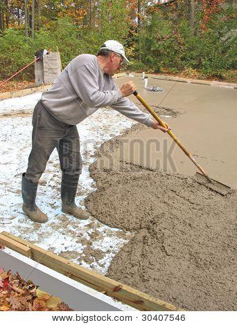Man leveling concrete slab