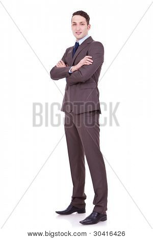 Full body portrait of happy smiling business man, isolated on white background . confident businessman with arms crossed on white backgroun