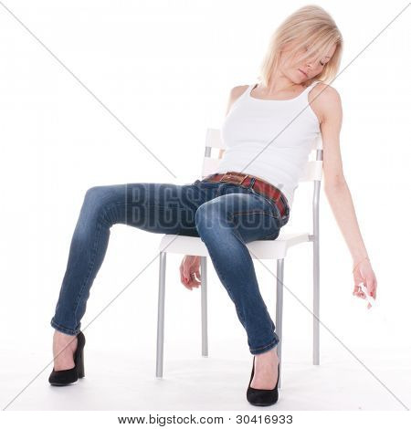 addict woman sits unconscious on the chair