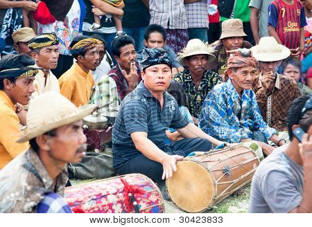 LOMBOK,INDONESIA- FEBRUARY 11: Indonesian man is playing drum on  February 11,2012 Lombok, Indonesia. Every ceremony is followed by local drums players giving the rythm