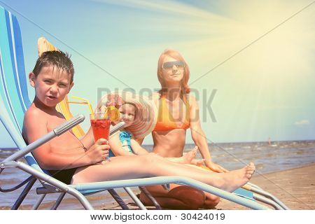 young family relaxing on beach (boy in focus)