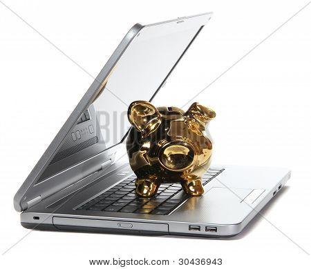 Golden Piggy Bank On Notebook