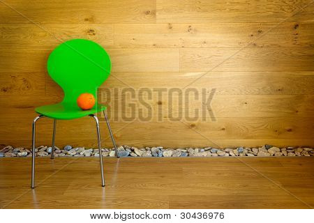 One green Chair and one Orange / empty room / modern interior