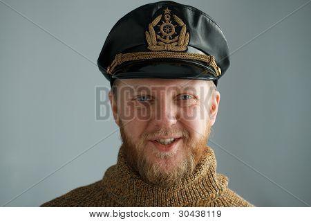 Smiling, Bearded Captain