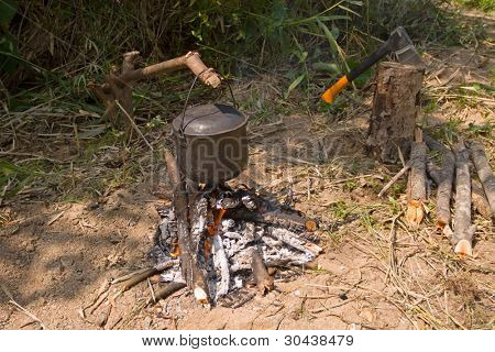 Picnic.Fire.Preparation of tea in pot on fire.