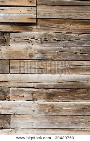 Wall of an old house from a wooden bar.