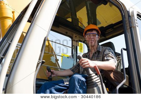 The operator of a excavator(dredge) on a working site.