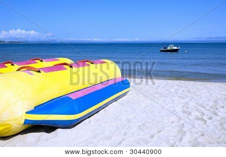 banana  boat lays on a beach