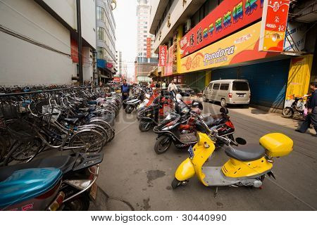 China.Street.Parking of bicycles, motor scooters and motorcycles.
