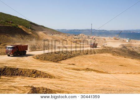 Construction of new seaport(oil harbor).Trucks.