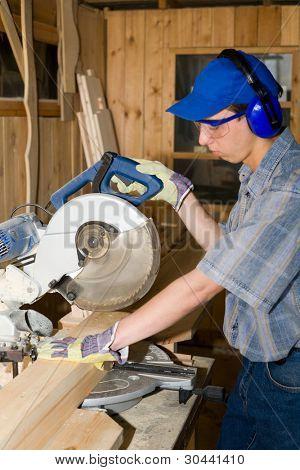 A carpenter(sawman) at work.