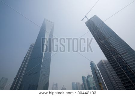 Lujiazui financial & Trade Zone in Shanghai. China. The left the highest building Shanghai World Financial Centre, 492 m. The right of him of construction of new office building. June, 2009.