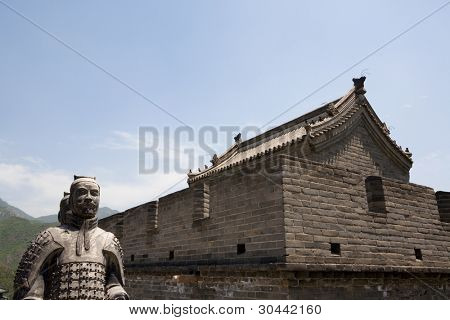 Chinese ancient stone warriors statues and tower on Great Wall of China. Near Beijing.