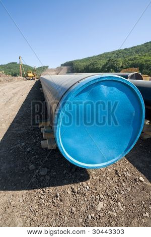 Construction new oil pipeline.Machine to twist pipes(pipelaying crane) in a pipeline construction.