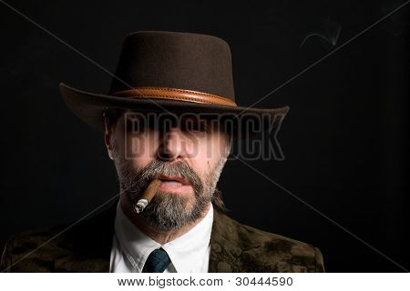 Stylish middle aged man with a cigar.