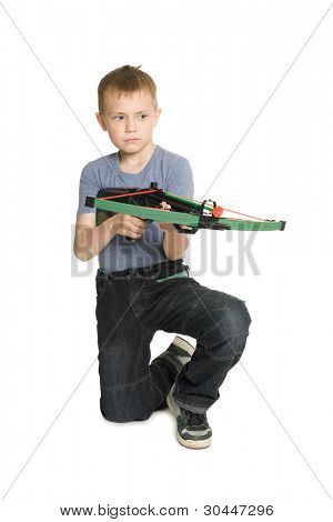 Blonde boy shooting a crossbow for children.