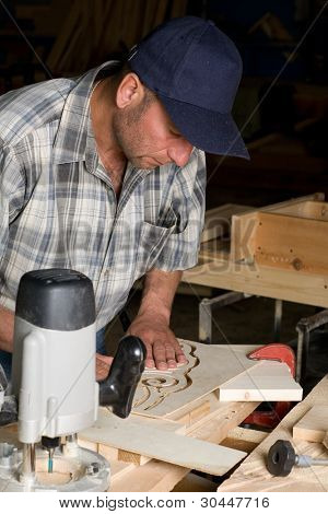 Carpenter working on the production of decorative detail.