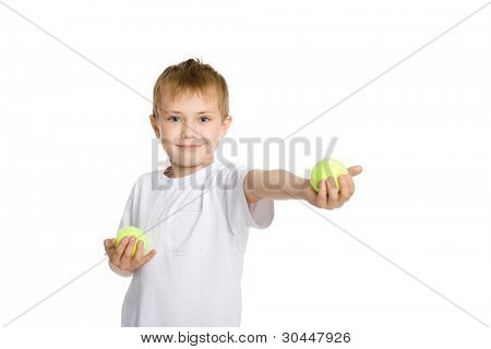 Blond boy playing in the tennis balls.