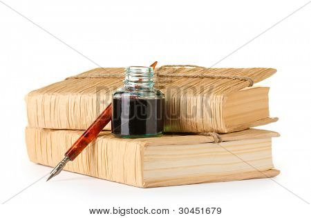 old books, ink pen and ink bottle isolated on white