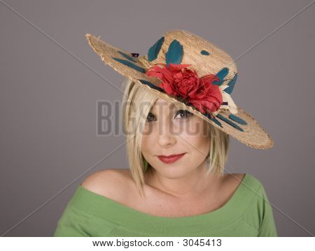 Blonde Flowered Hat Slanted Big Eyes