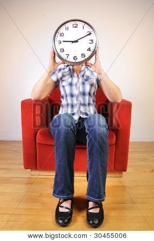 Woman Holding A Clock Covering Her Face